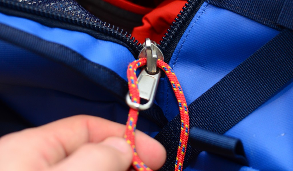 Fit the new cord through the zipper base hole, and through the loose metal-zipper part.